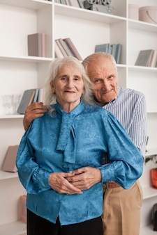 Adorable elderly couple hugging