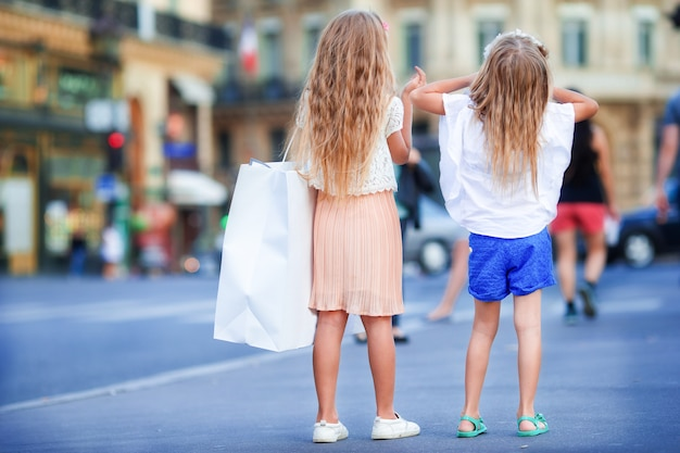 Adorable fashion little girls outdoors in european city