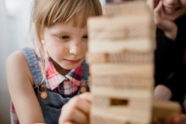 Adorable girl playing jenga