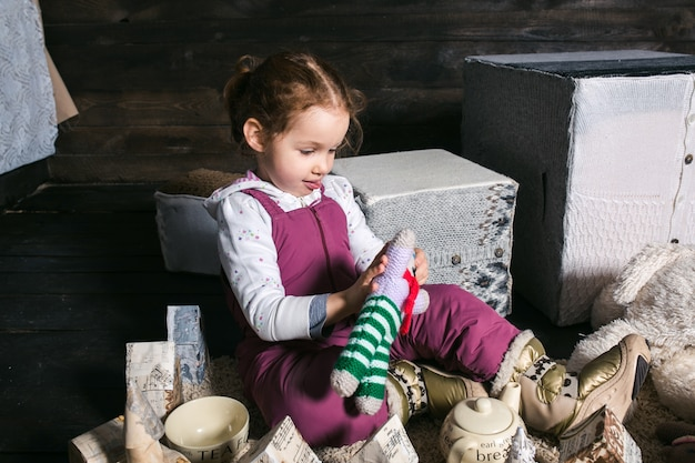 Adorable girl playing with a hand made house