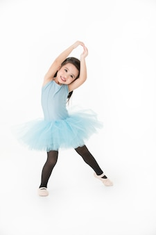Adorable girl in preforming ballet.