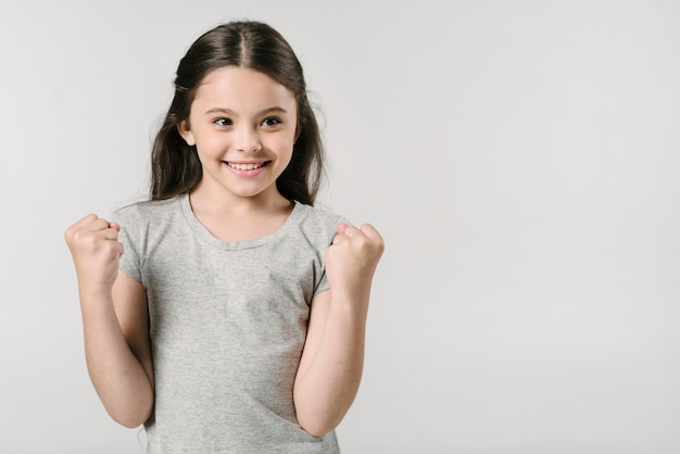 Adorable girl rejoices victory in studio