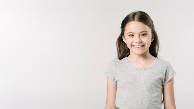 Adorable girl standing in studio