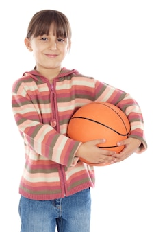 Adorable girl whit ball of basketball a over white background
