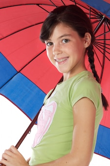 Adorable girl whit umbrella a over white background