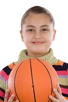 Adorable girl with basketball on a over white background