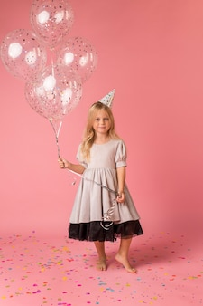 Adorable girl with costume and balloons
