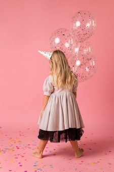 Adorable girl with costume and party hat