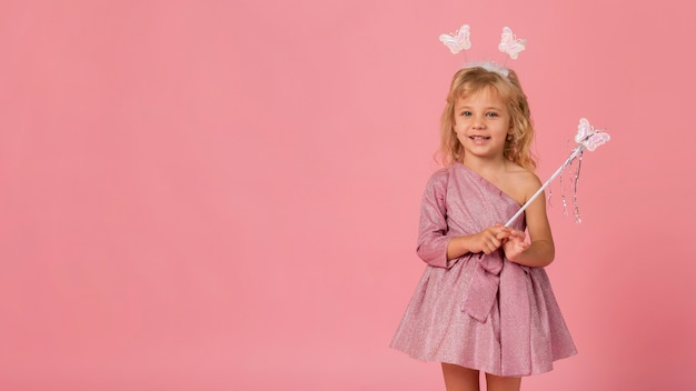 Adorable girl with fairy costume and copy space