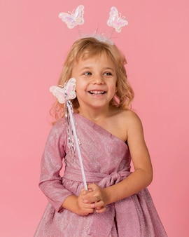 Adorable girl with fairy costume