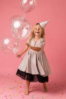 Adorable girl with party hat and costume
