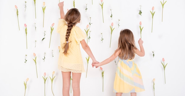 Adorable girls pointing at tulips