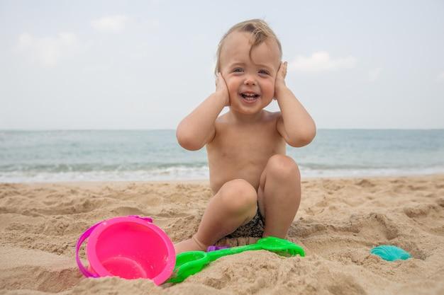 Adorable infant on sandy beach