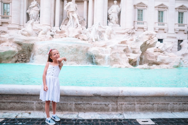 Adorable kid near fontana di trevi, rome, italy.