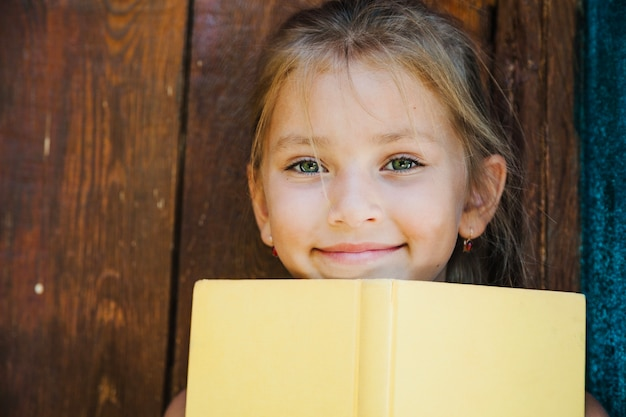 Adorable kid posing with book