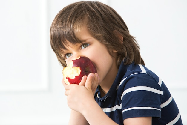 Adorable kid with apple