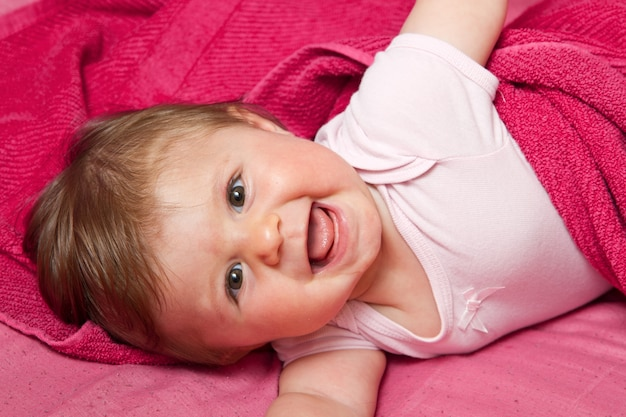 An adorable, laughing baby looking
