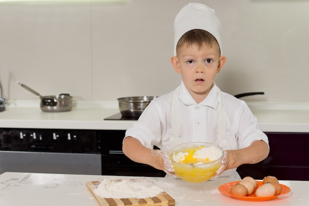 Adorable little boy pastry chef