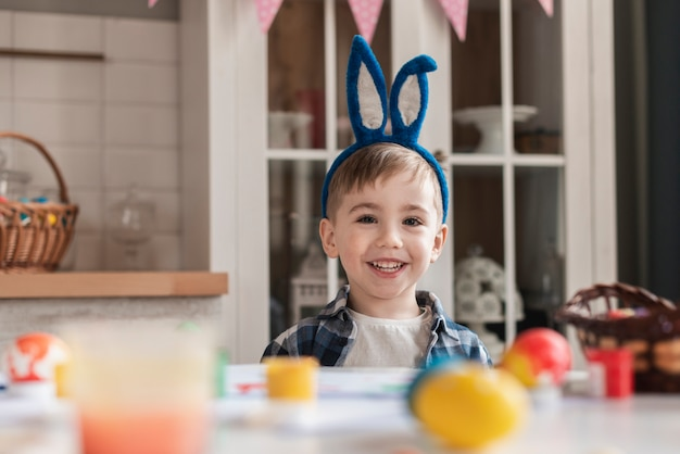 Adorable little boy with bunny ears smiling