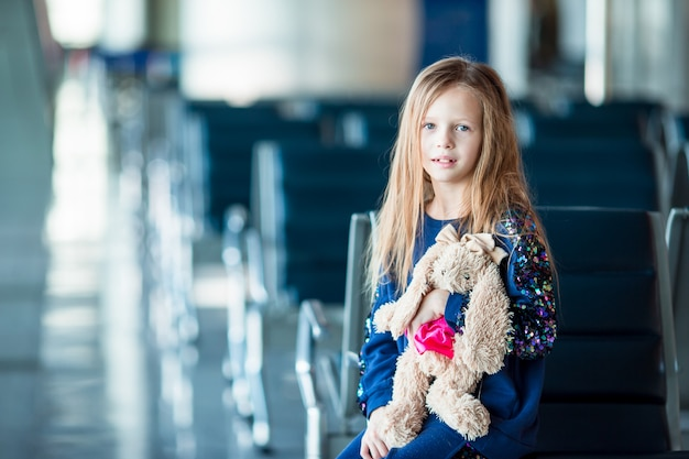 Adorable little girl in airport indoor before boarding