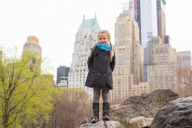 Adorable little girl in central park at new york city