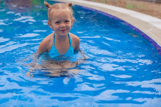 Adorable little girl enjoy in the swimming pool