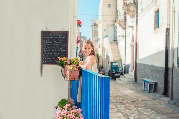 Adorable little girl in european city