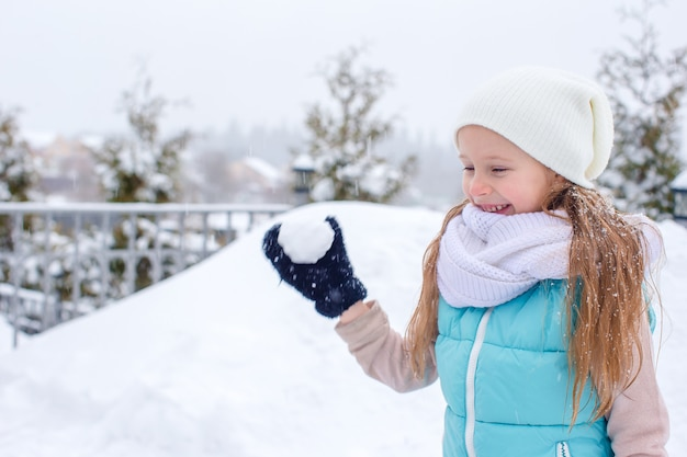 Adorable little girl in frozen winter day outdoors