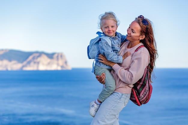 Adorable little girl and happy mother on summer vacation