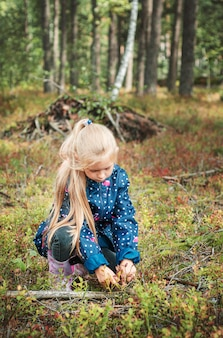 Adorable little girl hiking in the forest