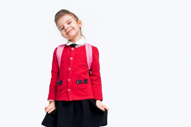 Adorable little girl in red school jacket black dress backpack