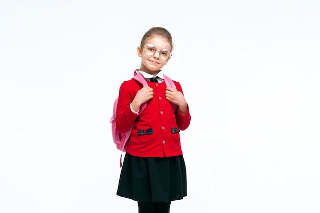 Adorable little girl in red school jacket black dress rounded