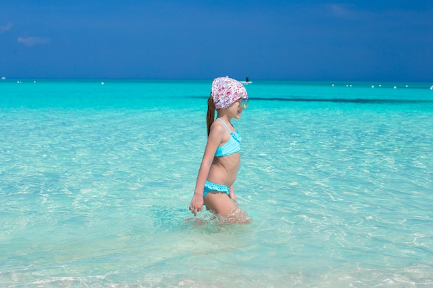 Adorable little girl in the sea during summer vacation