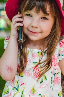 Adorable little girl talking on a mobile phone