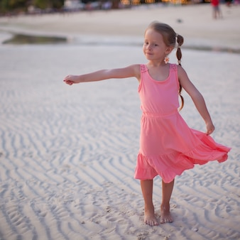 Adorable little girl on tropical beach vacation in phillipines