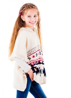 Adorable little girl in warm beige poncho