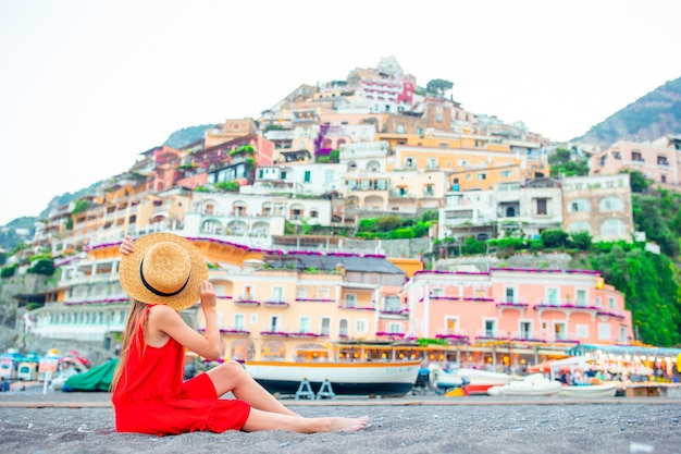 Adorable little girl on warm and sunny summer day in positano