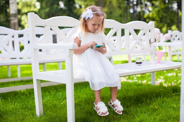 Adorable little girl at a wedding ceremony