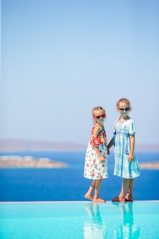 Adorable little girls enjoy their summer vacation in greece