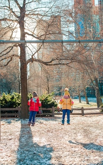 Adorable little girls having fun in central park at new york city
