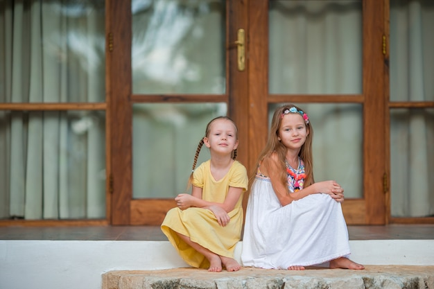 Adorable little girls on summer exotic vacation