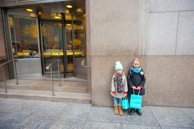 Adorable little girls walking in new york city at spring sunny day