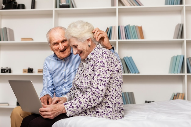 Adorable man and woman using a laptop