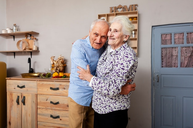 Adorable mature couple holding each other