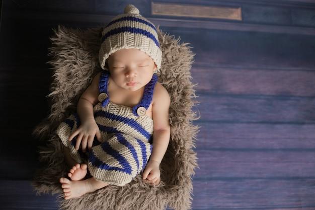 Adorable newborn baby sleeping in cozy room.