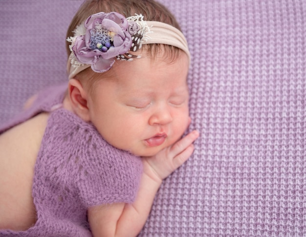 Adorable newborn in knitted suit