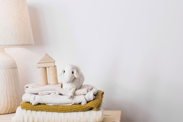 Adorable plush toy on blankets