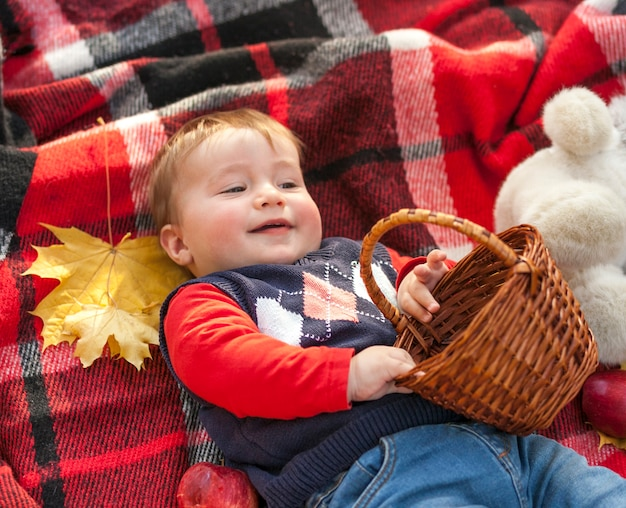 Adorable redhead baby holding a basket