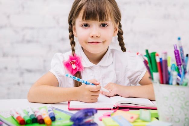 Adorable schoolgirl smiling at camera