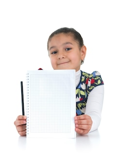 Adorable schoolgirl with homework done on white background